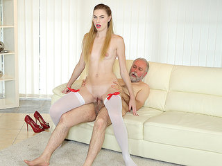 Old man bangs a sexy babe on the couch.